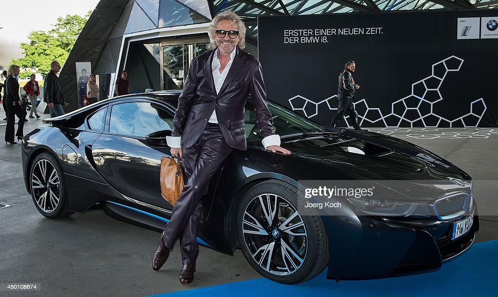 Bmw launches i8 photos and images getty images entertainer thomas gottschalk poses with a bmw i8 plug in hybrid sports car in front sciox Image collections