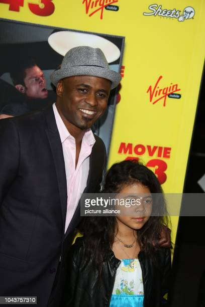 US entertainer Wayne Brady and daughter Maile Masako Brady arrive at the premiere of Movie 43 at Grauman's Chinese Theatre in Hollywood USA on 23...