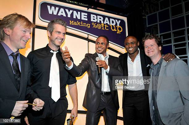 Entertainer Wayne Brady's wax figure stands between Musicians Cat Gray Trent Fancher Brady and comedian Jonathan Mangum after the figure was unveiled...