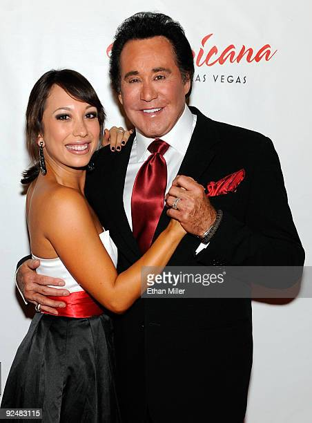 Entertainer Wayne Newton and dancer Cheryl Burke his partner from the show Dancing With the Stars arrive at the opening of Newton's limitedengagement...