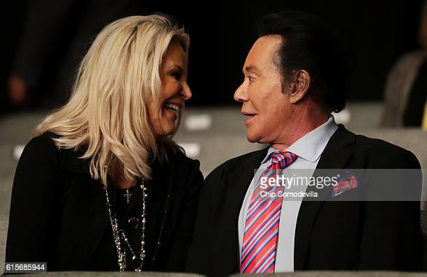 Entertainer Wayne Newton and his wife Kathleen McCrone wait for the start of the third US presidential debate at the Thomas Mack Center on October 19...