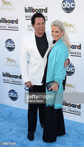 Entertainer Wayne Newton and Kathleen McCrone arrive on the red carpet for the 2013 Billboard Music Awards at the MGM Grand in Las Vegas Nevada May...