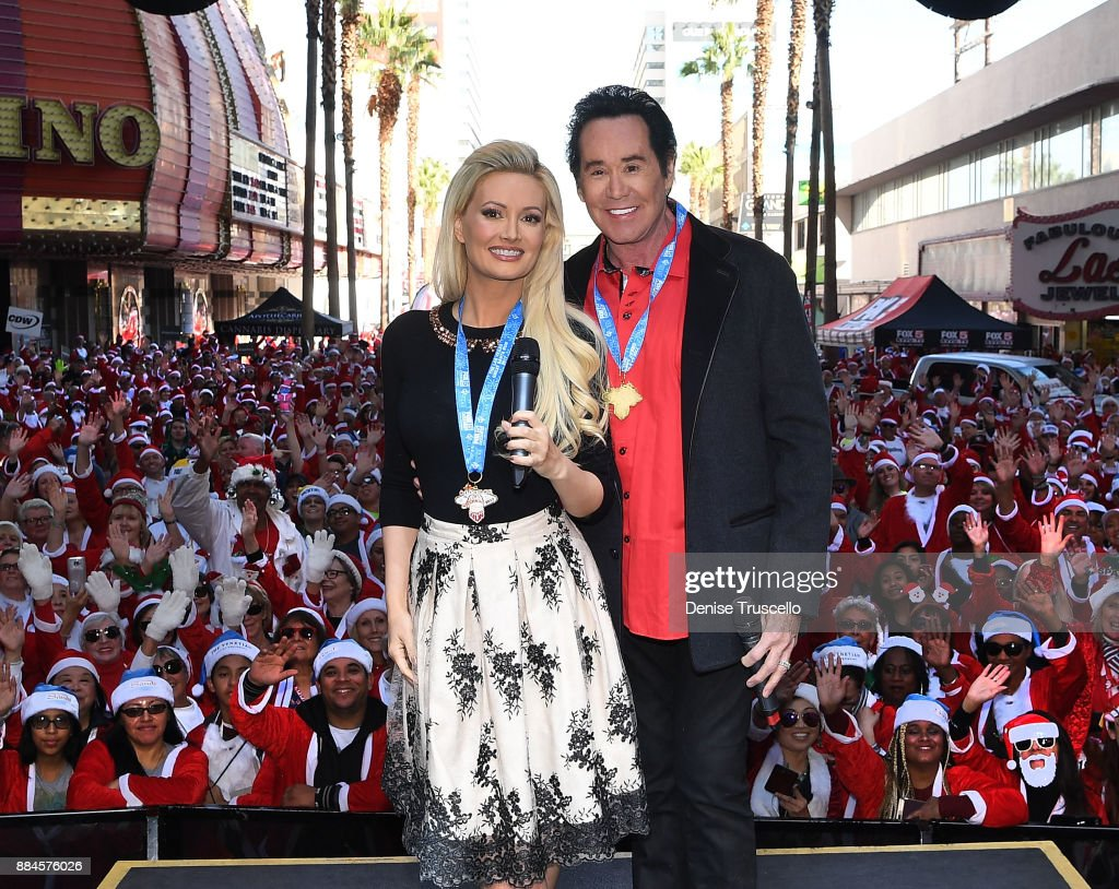 Entertainer Wayne Newton (L) and model, writer and television personality Holly Madison attend the 13th annual Las Vegas Great Santa Run benefiting Opportunity Village at the Fremont Street Experience on December 2, 2017 in Las Vegas, Nevada