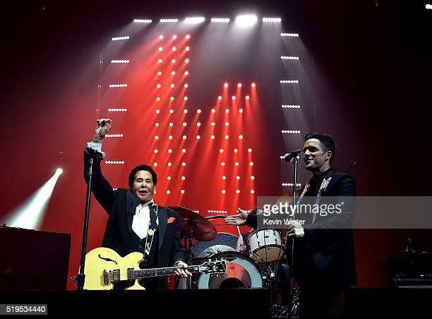 Entertainer Wayne Newton and musician Brandon Flowers of The Killers perform onstage during the grand opening of TMobile Arena on April 6 2016 in Las...