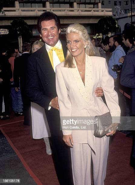 Entertainer Wayne Newton and wife Kathleen McCrone attend the 'Beverly Hills Cop III' Hollywood Premiere on May 22 1994 at Mann's Chinese Theatre in...
