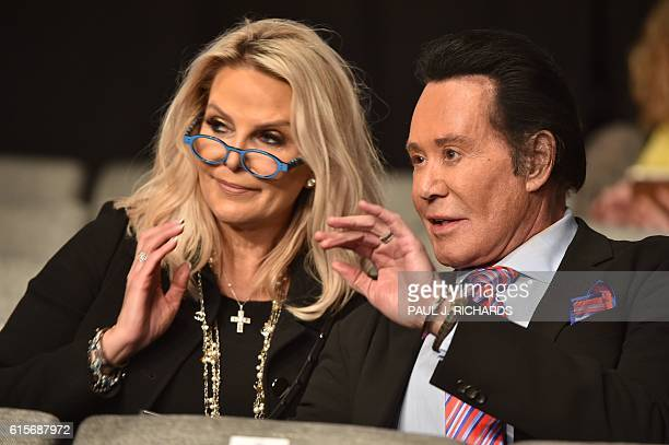 US entertainer Wayne Newton and wife Kathleen McCrone attend the third and final US presidential debate between Democratic nominee Hillary Clinton...