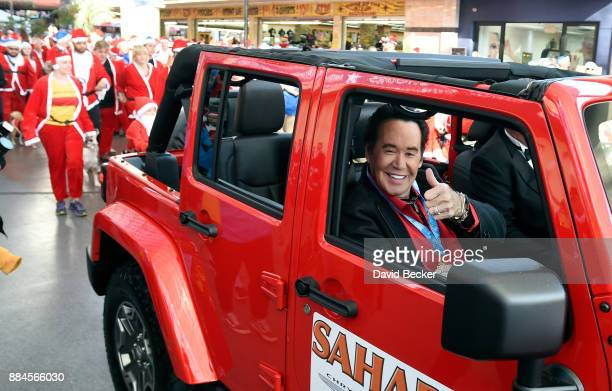 Entertainer Wayne Newton attends the 13th annual Las Vegas Great Santa Run benefiting Opportunity Village at the Fremont Street Experience on...