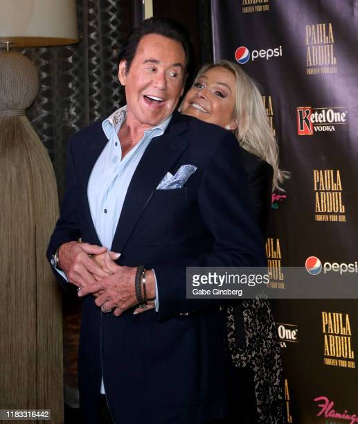 Entertainer Wayne Newton is photobombed by his wife Kathleen McCrone during the official opening for the Paula Abdul Forever Your Girl Flamingo Las...