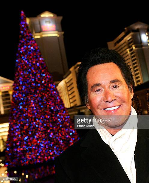 Entertainer Wayne Newton poses in front of Caesars Palace after hosting a lighting ceremony for a seven-story tall replica Rocky Mountain pine tree...