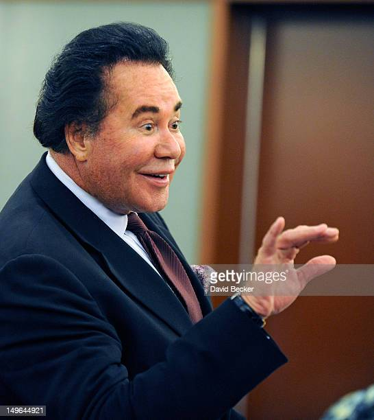 Entertainer Wayne Newton waves to an acquaintance during a short recess during a court hearing at the Clark County Regional Justice Center on August...