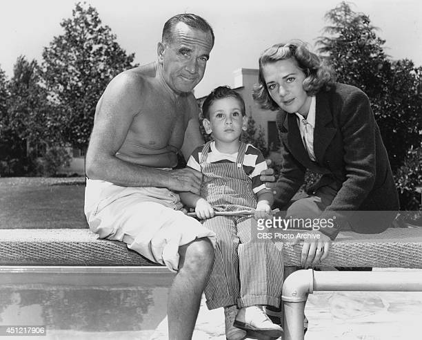 Entertainers Al Jolson and Ruby Keeler with son Al Jr pose poolside at their home in Los Angeles California in March 1938