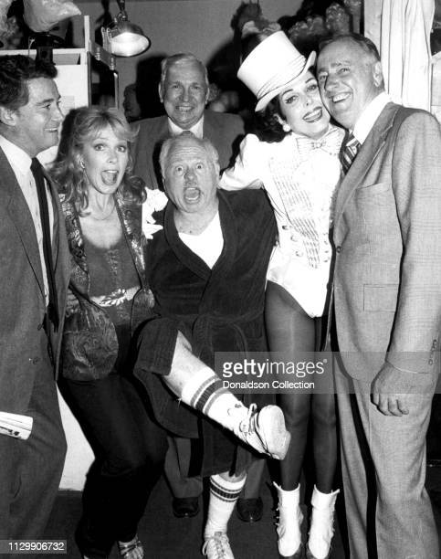 Entertainers Ann Miller Regis Philbin Stella Stevens Mickey Rooney Dick Martin and Slim Pickens backstage at Sugar Babies play in circa 1979