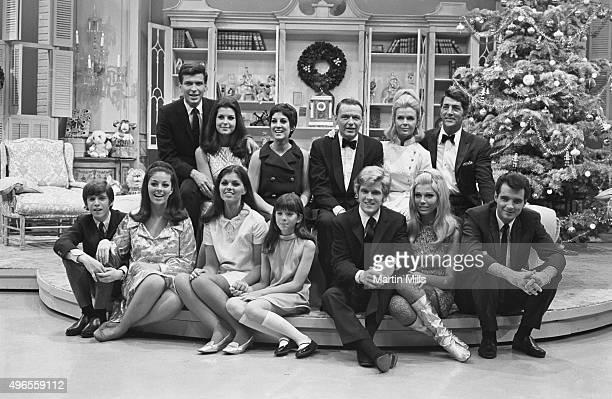 Entertainers Dean Martin and Frank Sinatra with with their families, Dean Paul Martin and Frank Sinatra Jr., Jeanne Martin, Tina Sinatra, Nancy...