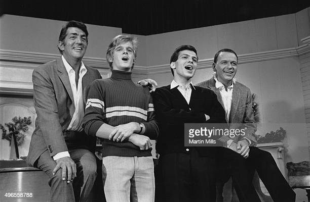 Entertainers Dean Martin and Frank Sinatra with with their sons Dean Paul Martin and Frank Sinatra Jr on the set of 'The Dean Martin Show' Christmas...