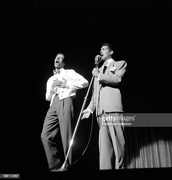 Entertainers Dean Martin and Jerry Lewis perform onstage at the New York Paramount Theatre on July 4 1951 in New York Jerry Lewis is wearing comical...
