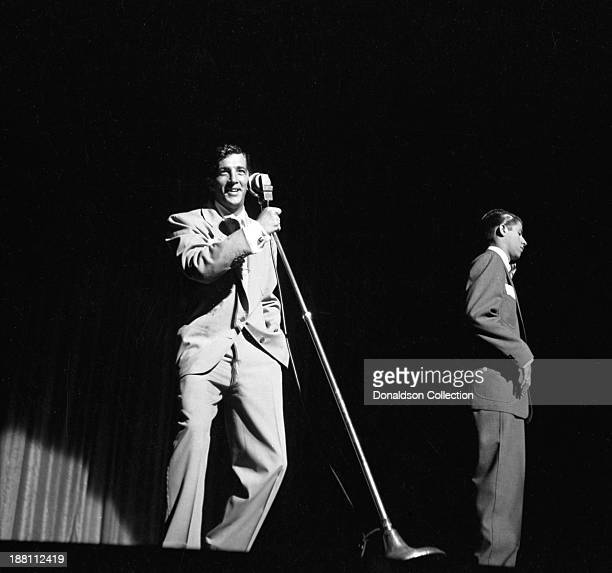 Entertainers Dean Martin and Jerry Lewis perform onstage at the New York Paramount Theatre on July 4 1951 in New York