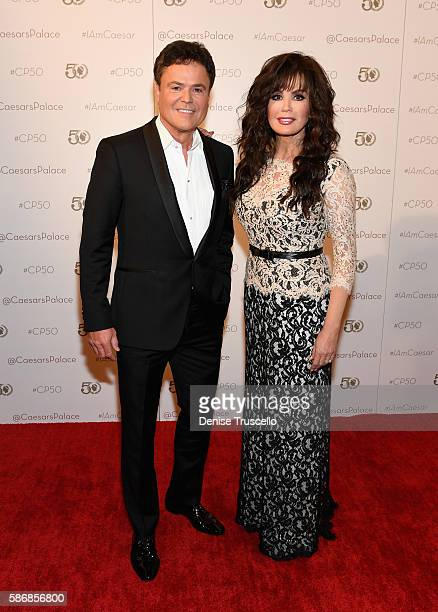 Entertainers Donny Osmond and Marie Osmond arrive at Caesars Palace during the resort's 50th anniversary gala on August 6 2016 in Las Vegas Nevada