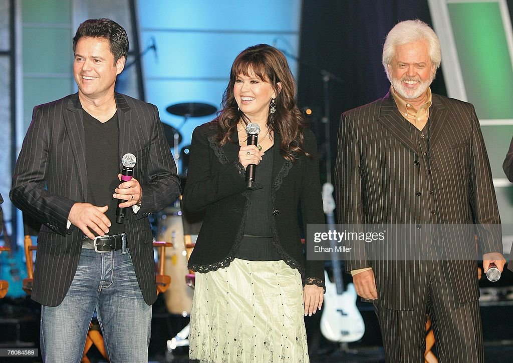 Entertainers donny osmond marie osmond and merrill osmond smile as the osmonds meet and greet fans in las vegas news photo m4hsunfo