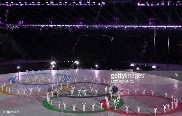 Entertainers form the Olympic rings during the closing ceremony of the Pyeongchang 2018 Winter Olympic Games at the Pyeongchang Stadium on February...