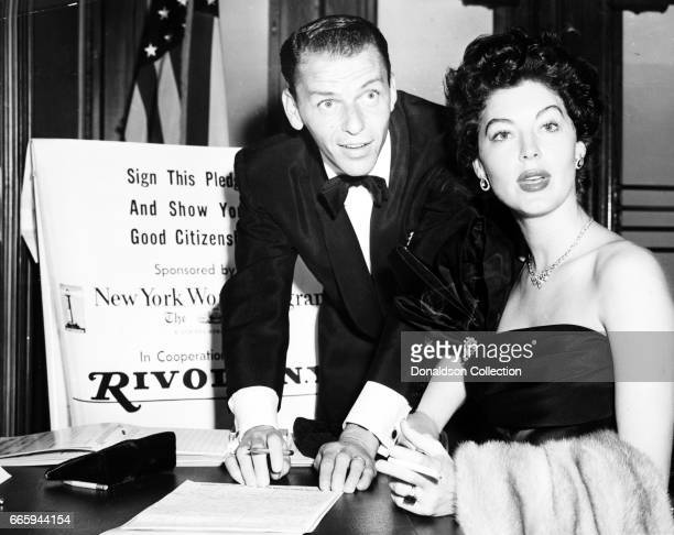 Entertainers Frank Sinatra and Ava Gardner sign a pledge as good ciitzens on September 19 1952 in New York New york