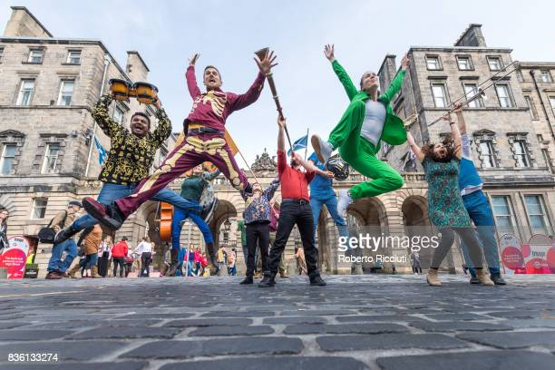 Entertainers from company Massive Vibe Live jump in front of City Chambers to promote their show 'Perfect as you are' on the Royal Mile during the...