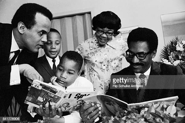 Entertainers Harry Belafonte and Bill Cosby read books and magazines with Martin Luther King Jr's children after their father's assassination