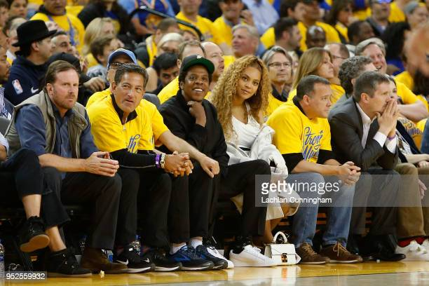 Entertainers JayZ and Beyonce look on during Game One of the Western Conference Semifinals between the New Orleans Pelicans and the Golden State...