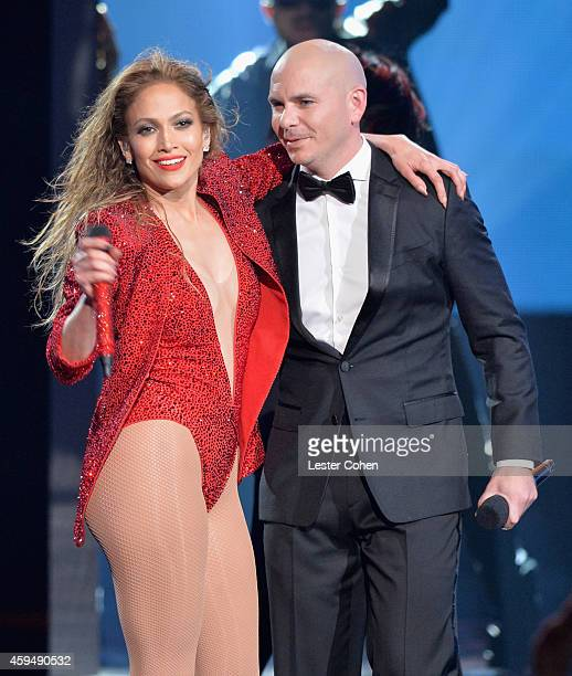 Entertainers Jennifer Lopez and Pitbull speak onstage at the 2014 American Music Awards at Nokia Theatre LA Live on November 23 2014 in Los Angeles...
