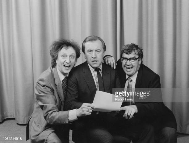 Entertainers Ken Dodd and Frank Carson pictured with host David Frost, photographed in connection with the BBC Radio 2 show 'Pull the Other One',...