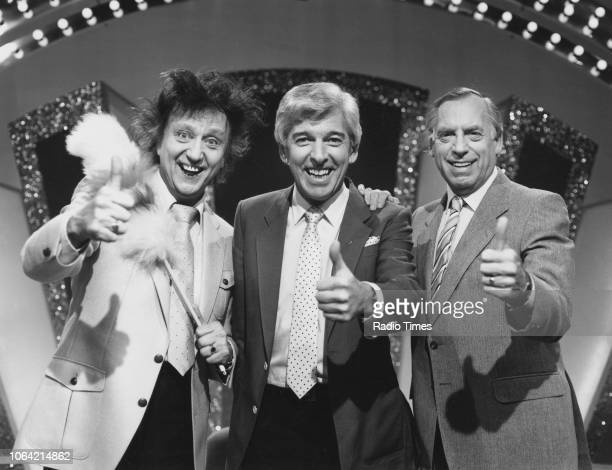 Entertainers Ken Dodd, Tom O'Connor and Larry Grayson giving the tHuman Interestbs up on the set of the television series 'A Question of...
