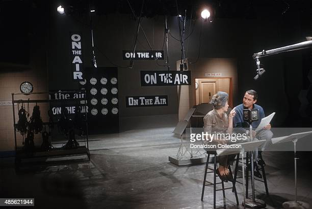 Entertainers Martha Raye and Perry Como rehearse on set of the TV show Perry Como's Kraft Music Hall in New York