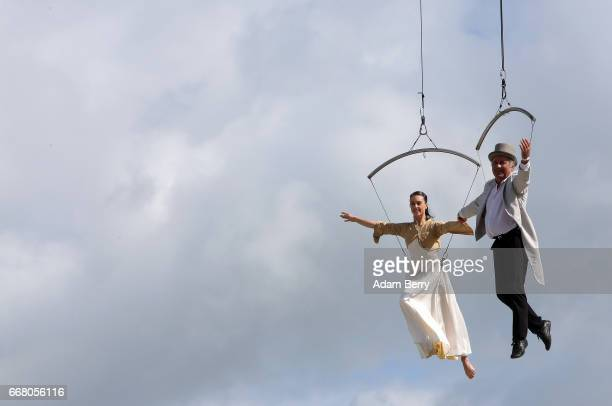 Entertainers perform an acrobatic act during the opening of the IGA International Garden Exhibition on April 13 2017 in Berlin Germany The showcase...