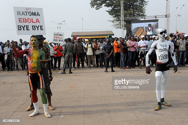 Entertainers perform during the Bye bye Au revoir Ebola memorial concert on December 30 2015 in Conakry International artists Youssou Ndour Tiken Jah...