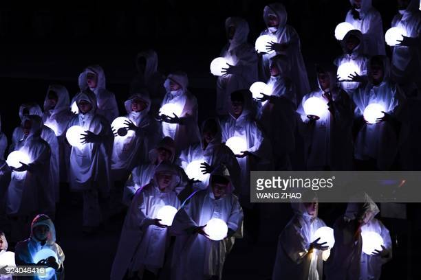 TOPSHOT Entertainers perform during the closing ceremony of the Pyeongchang 2018 Winter Olympic Games at the Pyeongchang Stadium on February 25 2018...