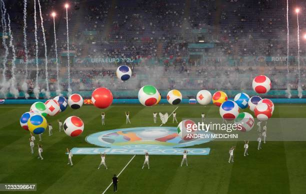 Entertainers perform during the opening ceremony before the UEFA EURO 2020 Group A football match between Turkey and Italy at the Olympic Stadium in...