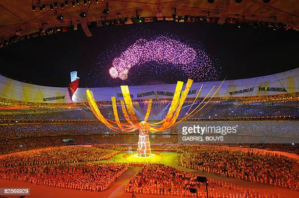 Entertainers perform under the extinguished Olympic flame during the closing ceremony for the 2008 Beijing Olympic Games at the National Stadium also...