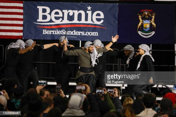 Entertainers perform while attendees wait for Democratic presidential candidate Sen. Bernie Sanders to speak at a campaign rally at Salina...