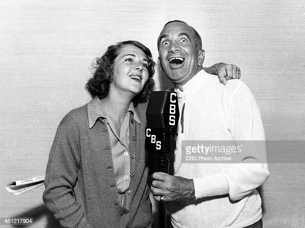 Entertainers Ruby Keeler and Al Jolson perform together on the CBS radio network in 1938 in Los Angeles California