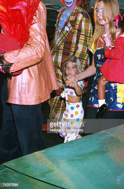 Entertainers Sonny Bono and Cher attend the circus with their daughter Chastity Bono as Cher performed as ringmaster at the opening day of the...
