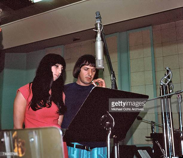 Entertainers Sonny Bono and Cher record in the studio at a Neumann mic in April 1966 in Los Angeles California