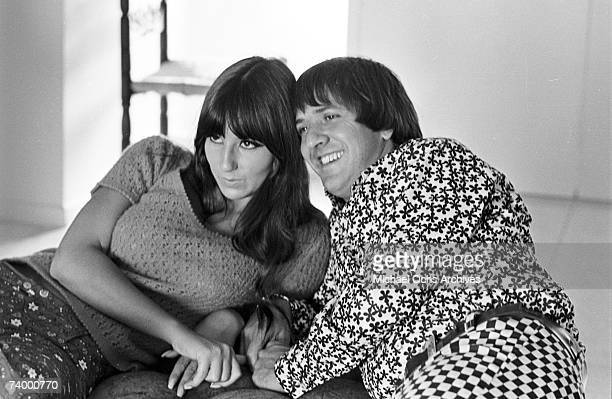 Entertainers Sonny Bono Cher pose for a portrait session at home in August 1966 in Los Angeles California