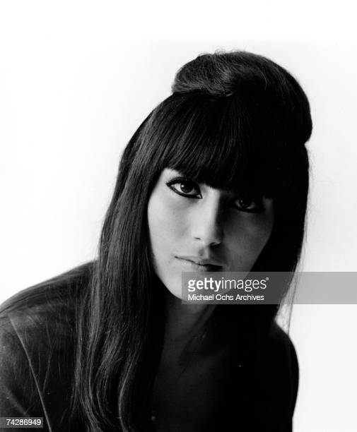 Entertainers Sonny Bono Cher pose for a portrait session in October 1964