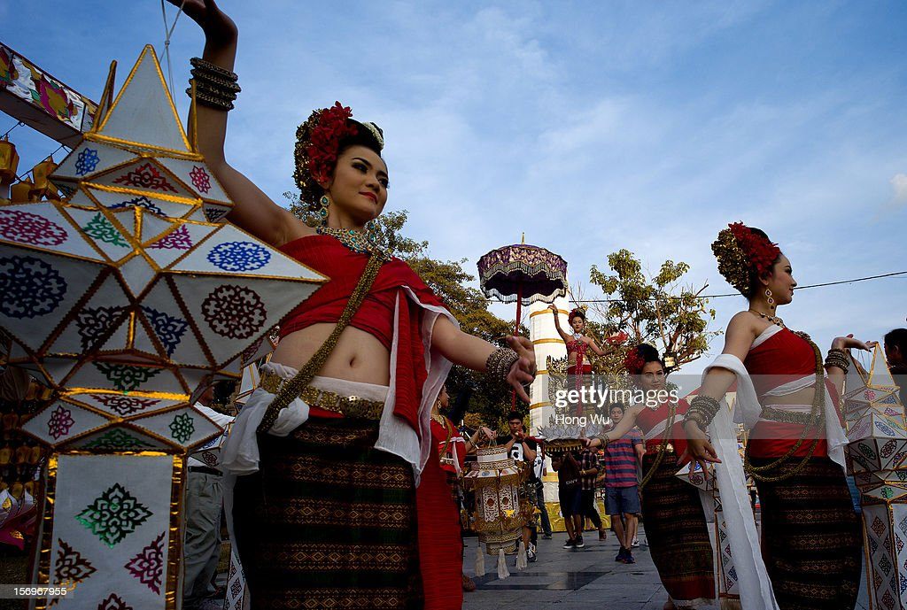 Entertainers wear Thai traditional clothes to perform during a celebration ceremony on November 25, 2012 in Chiang Mai, Thailand. Chiang Mai is the largest and most culturally significant city in northern Thailand. It's a former capital of the Kingdom of Lanna (1296-1768) and was the tributary Kingdom of Chiang Mai from 1774 until 1939. In recent years, is has become an increasingly modern city and has been attracting over 5 million visitors each year, of which between 1.4 million and 2 million are foreign tourists.