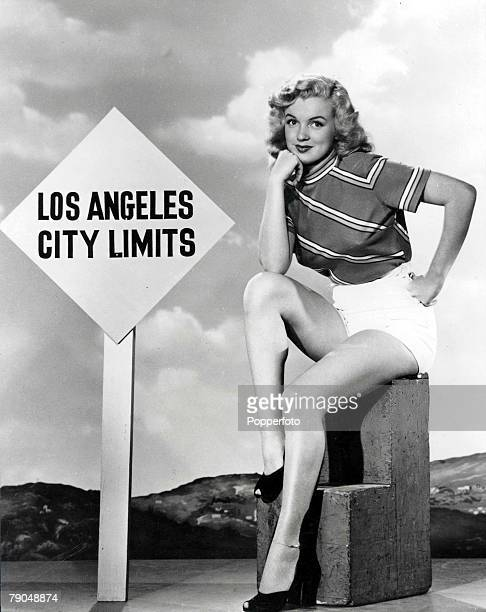 Entertainment American film legend Marilyn Monroe poses in front of a signpost reading Los Angeles City Limits wearing tshirt and shorts