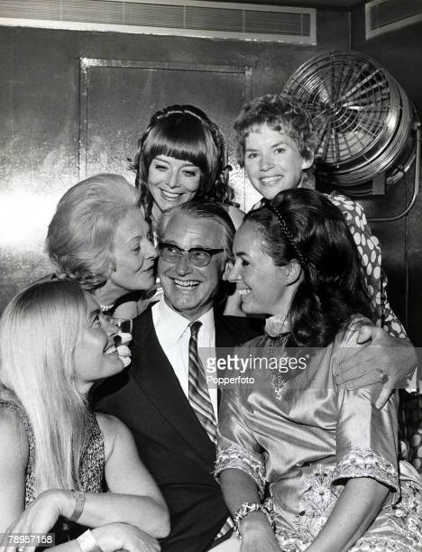 Entertainment London England 18th July 1969 Film Director Ken Annakin poses with guests at his party for stars who have appeared in his films...