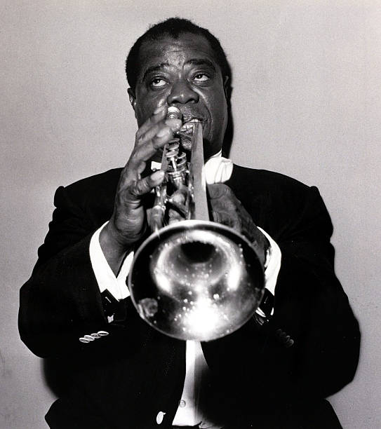 Entertainment. Music. circa 1950+s. Portrait of Louis Armstrong (1901-1971) playing his trumpet. The famous Jazz singer and musician with his innovative and unique style influenced much popular music this century. Louis Armstrong and his orchestra were on