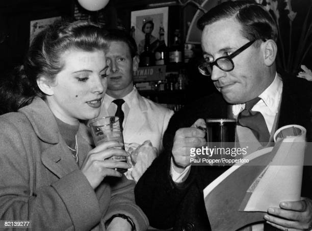 21st February 1954 Actors Billie Whitelaw and Eric Barker take the script to the pub as they rehearse for the stage play Where There's A Will There's...