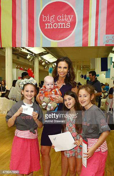 Entertainment Reporter for CBS 2 Jill Nicolini holds her son Austin Nicolini during Big City Moms Biggest Baby Shower Ever NYC 2015 held at the...