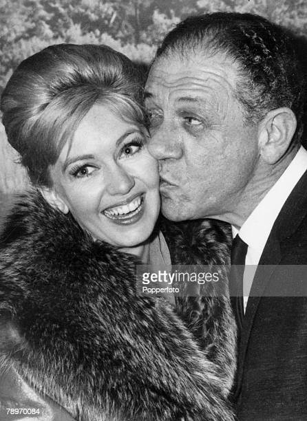 November 1964 Northampton Northamptonshire England Comedian Sid James gives film star Janette Scott a kiss at a jazz festival at Northampton Drill...