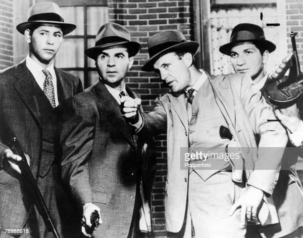 1960's The stars of the US Television crime programme The Untouchables leftright Abel Fernandez Paul Picerni Robert Stack playing Eliot Ness and...